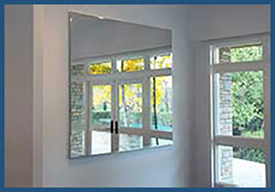Popular style of a custom mirror using a thin metal frame.
