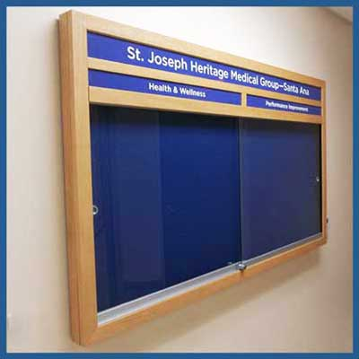 Create custom enclosed cord bulletin board to your exact size - swing door or sliding door - 12 x 12 inches to 4 feet x 8 feet.